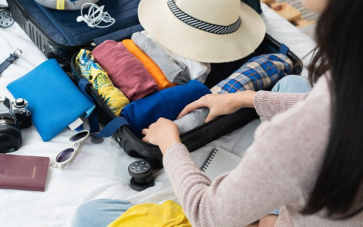 girl packing luggage for a week