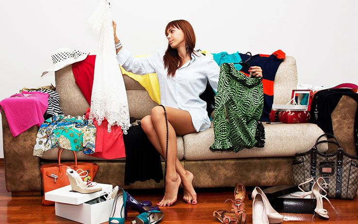 girl choosing clothes for carry-on only travel
